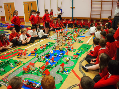 Classroom photo of kids around the Lego Town Building Workshops